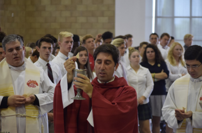 Fr. Martin raises the blood of Christ during the All Saints Day Liturgy on Nov. 1.