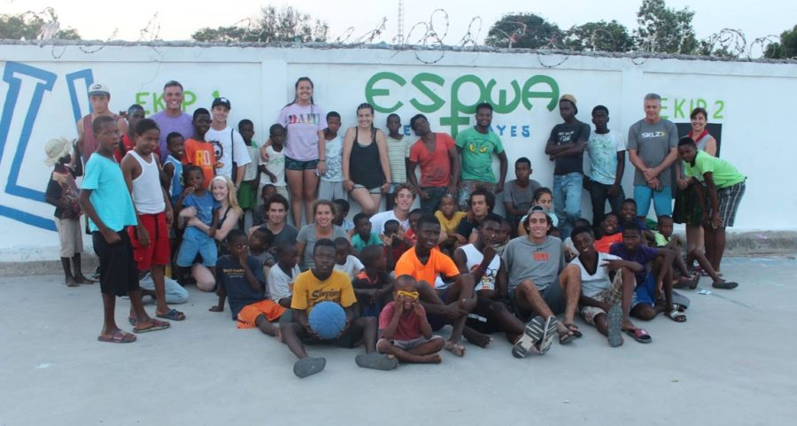 Gathering+with+locals+at+the+Pwoje+Espwa+Orphanage+in+Haiti+during+a+service+trip%2C+CCHS+students+dedicated+to+living+the+call+of+the+Project+One+club+demonstrate+their+commitment+to+global+service+efforts.