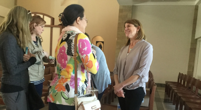 After+delivering+an+emotional+faith+talk%2C+Dr.+Cyndi+Peterson+%28far+right%29+visits+with+members+of+the+Parents+in+Prayer+group.