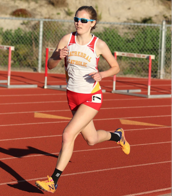 CCHS+student+and+four-year+track+and+field+athlete+Alex+Cerveny+%E2%80%9817+rounds+the+final+corner+of+her+1600+meter+race+during+the+recent+tri-meet+against+Mt.+Carmel+High+School+and+Valley+Center+High+School.