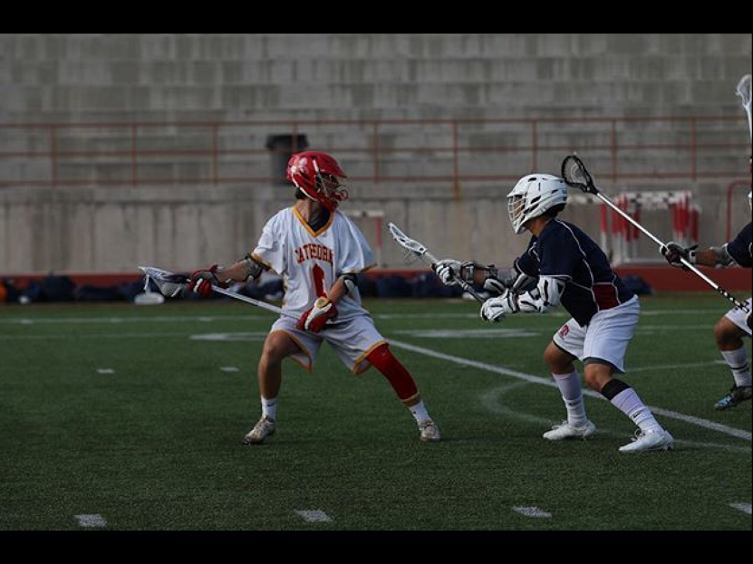 CCHS+lacrosse+player+Connor+Mataczynsky+%E2%80%9818+dodges+an+opposing+player+attempt+to+give+the+Dons+a+lead+in+its+close+game+against+the+Vikings.