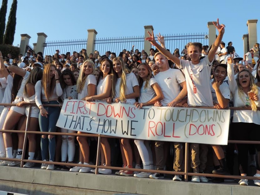 The class of 2017 embraces its school spirit, donned in all white, as it cheers for the varsity football team during one of the last home football games of the year.