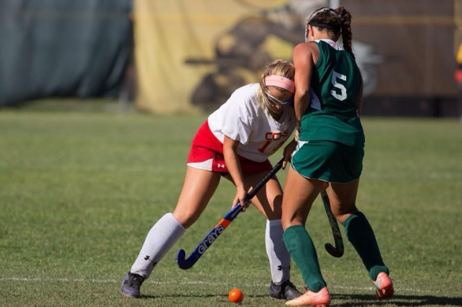 Chloe Riddlespurger, the only freshman on the team, competing on the field