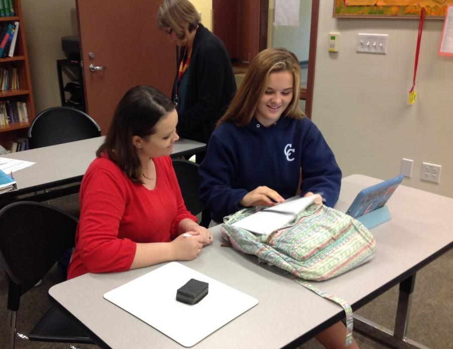 Mrs. Kimberly McHugh helping a student in the Learning Center
