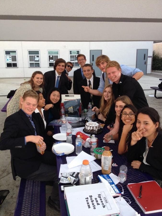 CCHS Debate Team members gather around a table for pictures.
