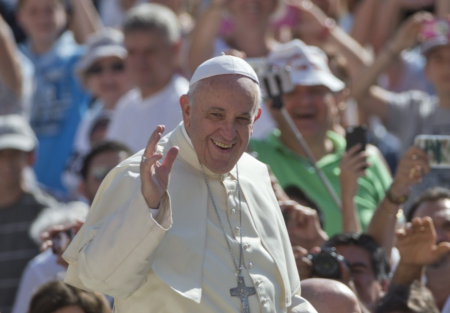In this Wednesday, Aug. 26, 2015, file photo, Pope Francis waves as arrives for his weekly general audience in St. Peter's Square at the Vatican. (AP Photo/Alessandra Tarantino, File)