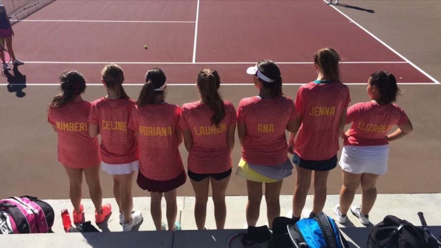 Girl's Varsity B tennis players try on their new CCHS spirit shirts.