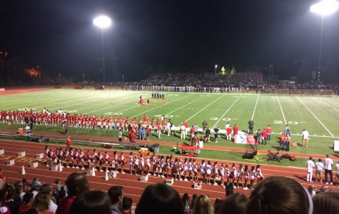 Cheer and football teams line up for the national anthem at the Holy Bowl, Friday Oct. 23, 2015.
