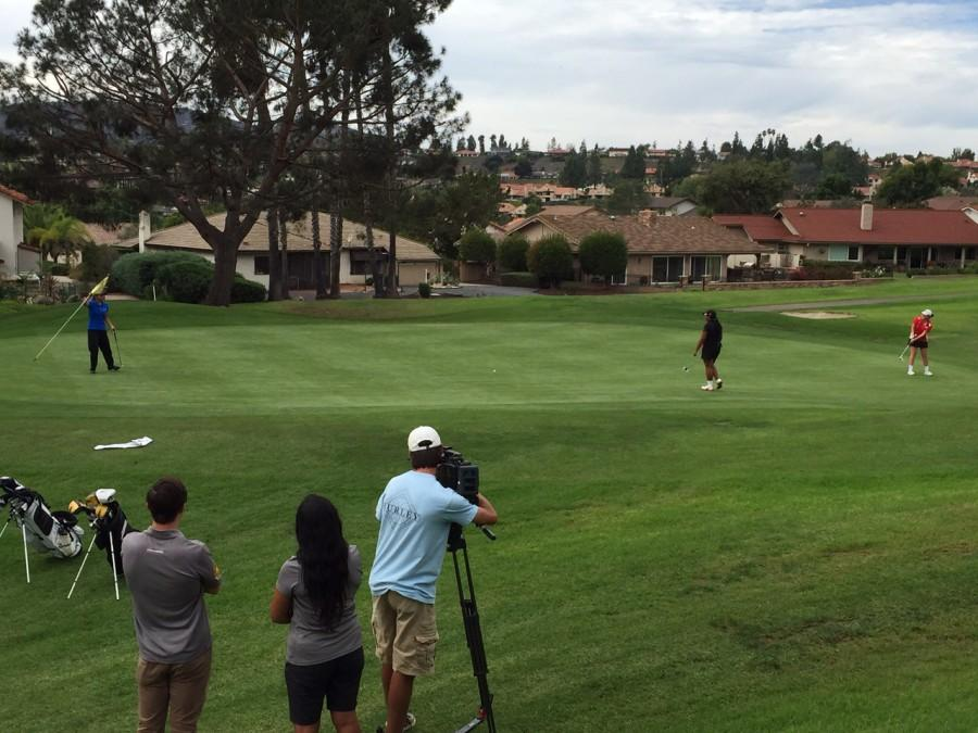 With a TV news camera rolling, CCHS junior Jackie Garcia lags a long putt at the City Conference Match Play Tournament.
