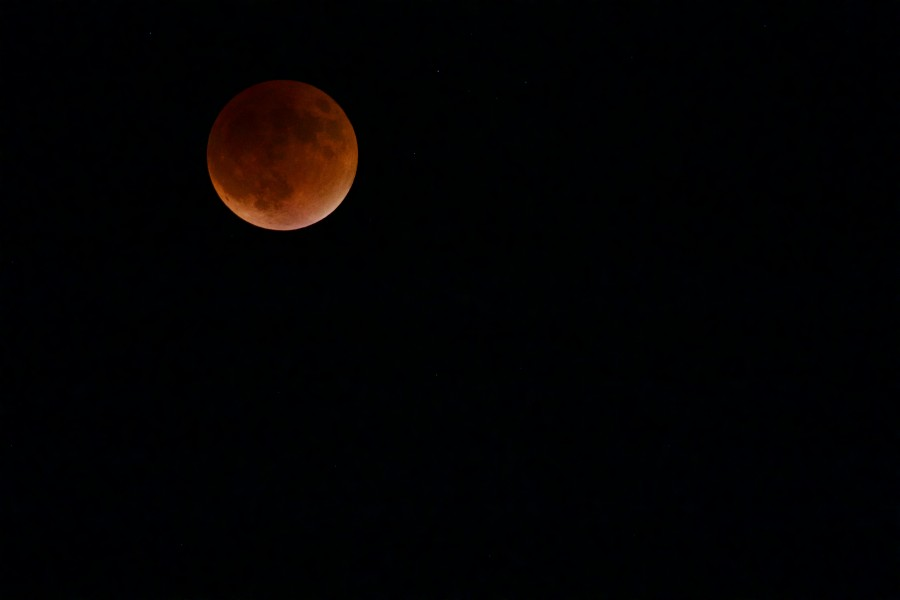 Supermoon lunar eclipse combination seen on Sunday night is rare: it won't be seen again until 2033.