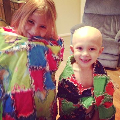 Liam Webb poses with his sister as both don handmade blanket capes.