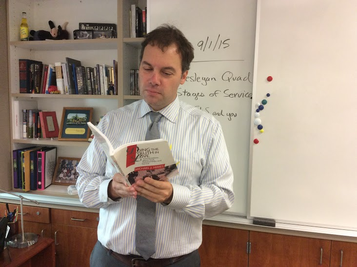 New campus ministry teacher Mr. Nicolas Hurt stresses the importance of service in living a Christian life.