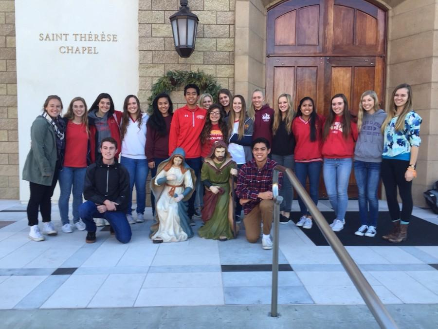 Alumni and Campus Ministry members gather for one last mass before Christmas break.