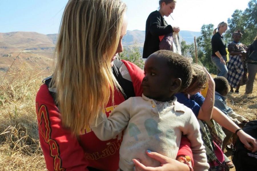 McKenna embracing her new friend Manisha in South Africa