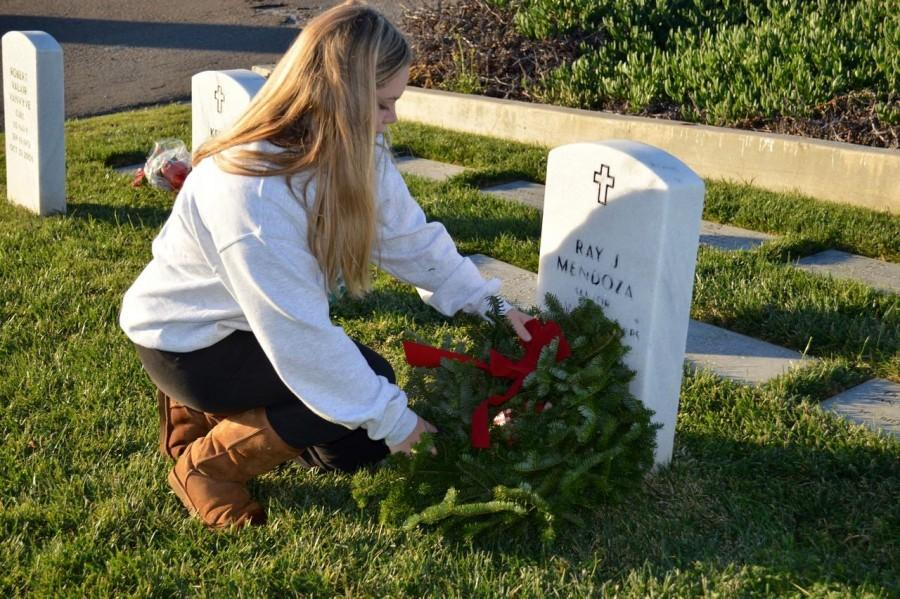 San Diegans place wreaths at Fort Rosecrans and Miramar National Cemeteries this Christmas season to honor deceased military veterans.
