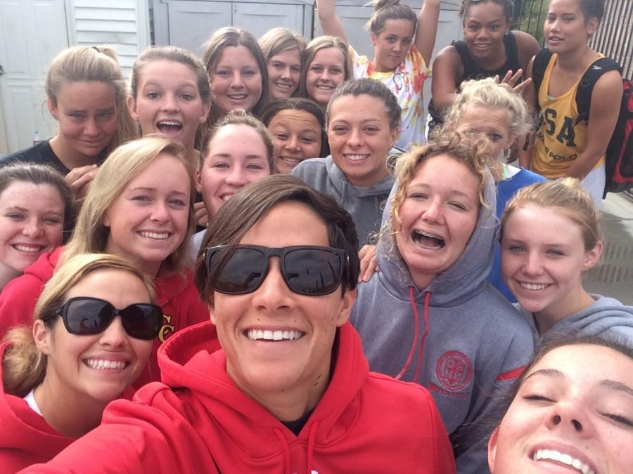 Lady Dons water polo players smile for a photo together.