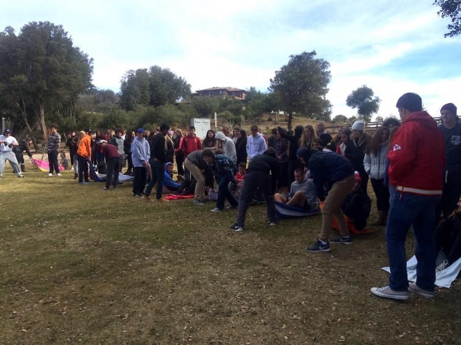 Senior Campus Minister Gino Licosati '16 leads a large group game at Junior Retreat at Whispering Winds.