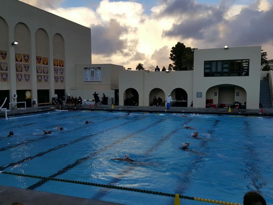 Lady Dons varsity water polo team faces off against Bishops after a stormy afternoon.