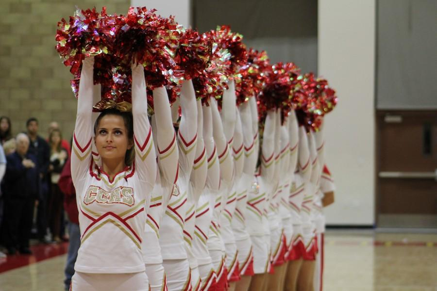 Gracie Francis '16 leads the cheerleaders in a spirited display for the National Anthem.