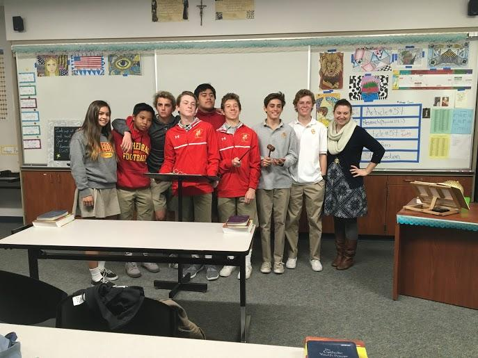 Ms. Amanda Gustafson's speech communications class poses before giving presentations. The now-required class will still be included in course offerings next year, but will no longer be a required freshman course.
