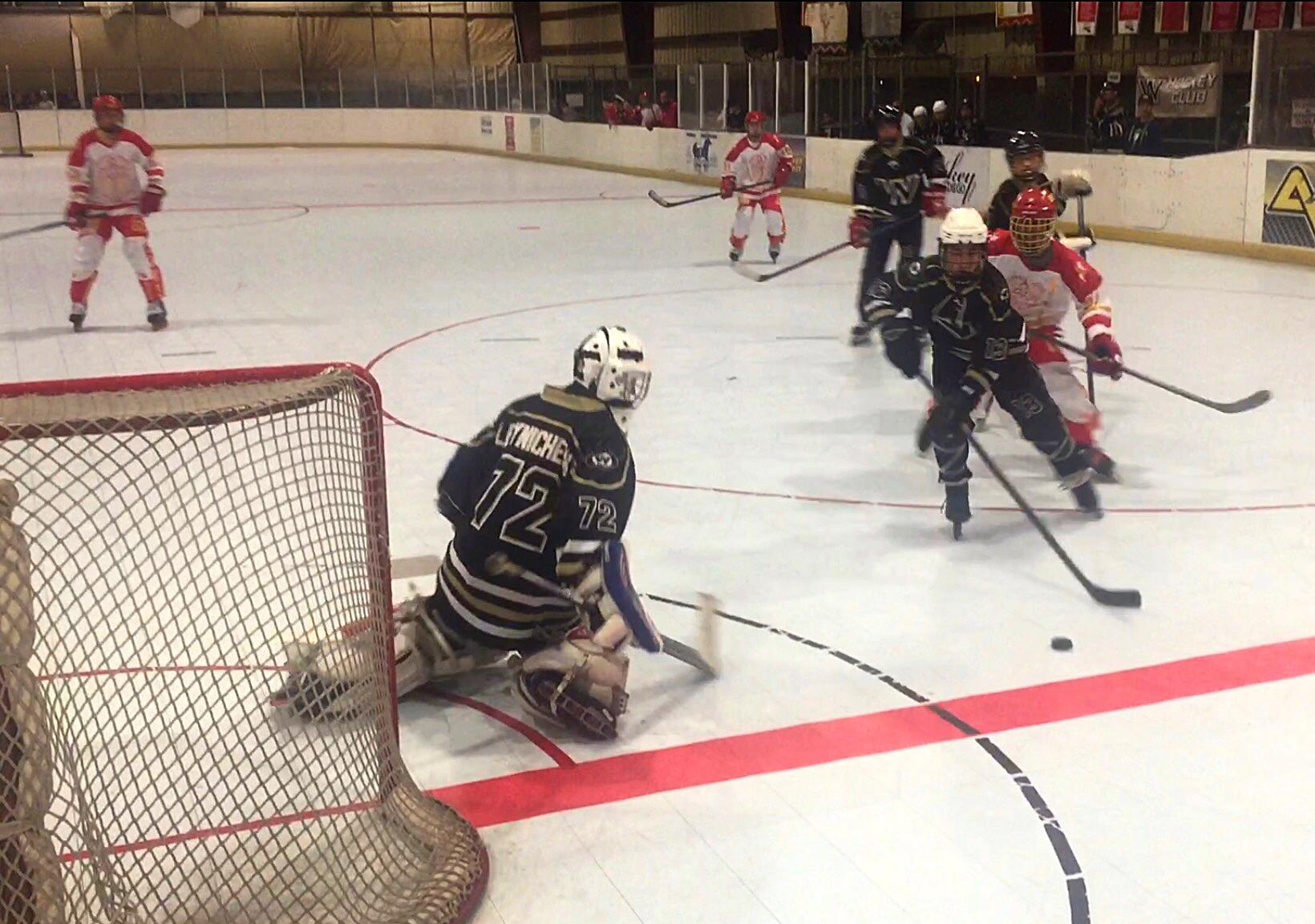 Westview High School's Josh Morrison '17 steals the puck from Cathedral Catholic High School's John Leone '16 11 minutes into the third period of the CIF championship match  Wednesday evening. The contest marked the end of another fine season for the CCHS inline hockey team.