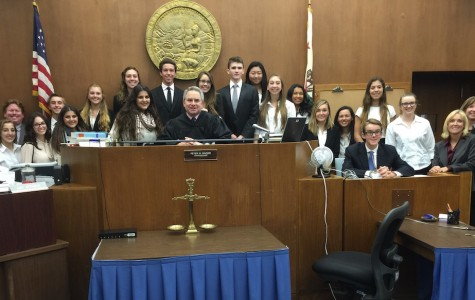 The mock trial team takes a final team picture at the last day of the competition with judge Peter Singer. While both the defense and prosecution for CCHS had a good run, the Academy of Our Lady of Peace ultimately secured the victory over all the teams in San Diego.