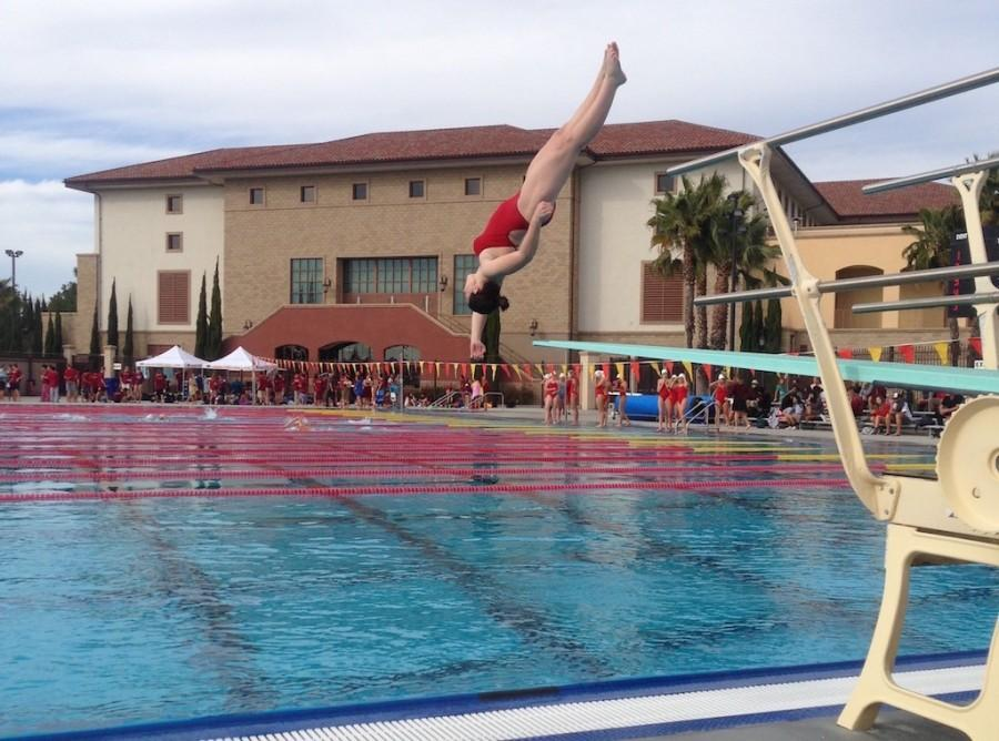 Cathedral Catholic High School diver Kristin Sondys executes a front somersault full twist dive on Thursday, when CCHS swim and dive teams competed in the annual CCHS tri-meet against Del Mar Heights rivals Torrey Pines and Canyon Crest Academy.