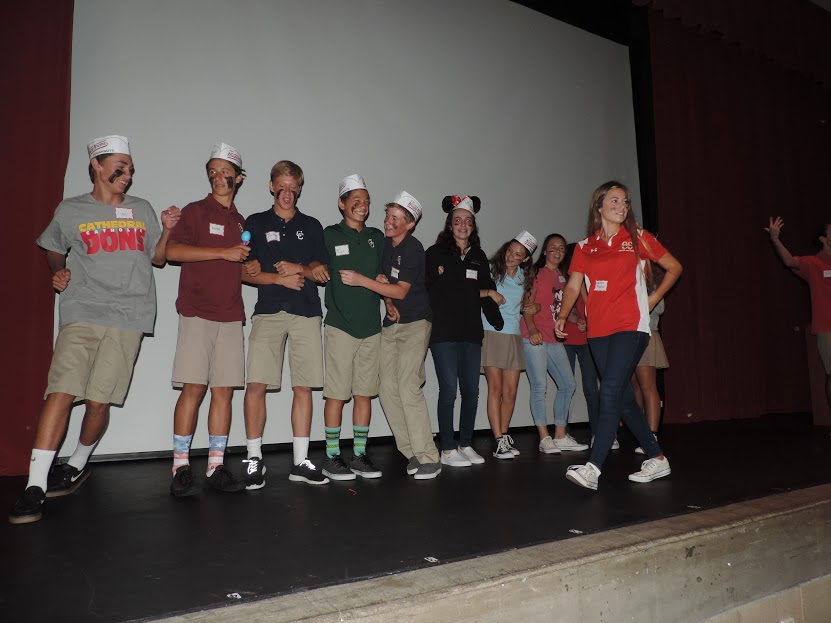 CCHS Campus Minister Lauren Tropio '17 leads freshmen in a prayer skit during the recent Freshman Retreat. Incoming freshmen spent the day worshipping, singing, and building relationships.