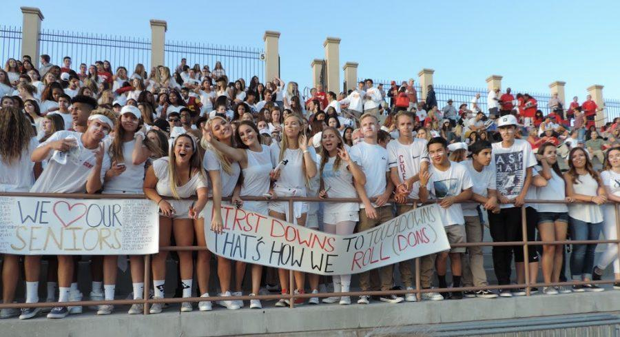 Los Locos, the CCHS student-led spirit club, underwent several changes this year to involve the entire school community. Here, the group leads cheers at the recent first home game.