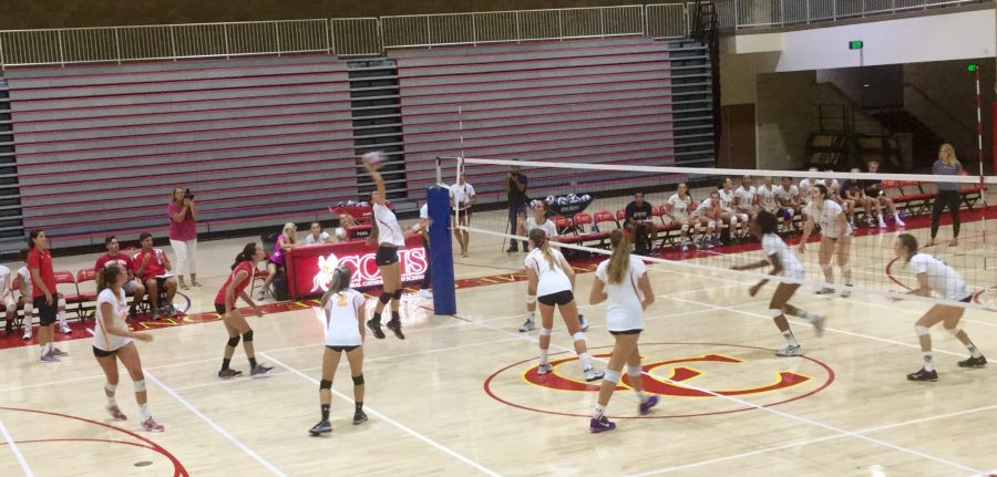 The Lady Dons varsity volleyball team spikes the ball across the net for a 3-1 victory against Del Norte High School.
