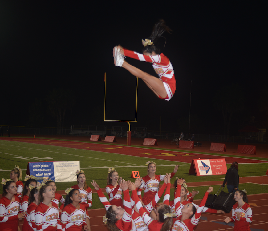 Annalise Castro' 17 soars through the Friday night lights during the fourth quarter of the Homecoming game at Manchester Stadium.