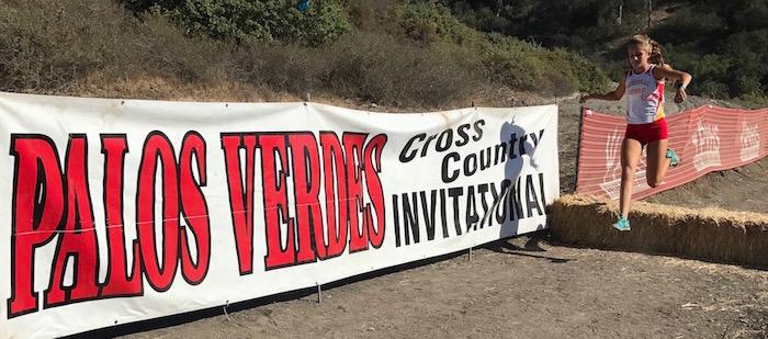 Lauren Munro '19 barrels over obstacles on the Palos Verdes Invitational course last Friday, pacing herself throughout the race in order to claim first place for her group.