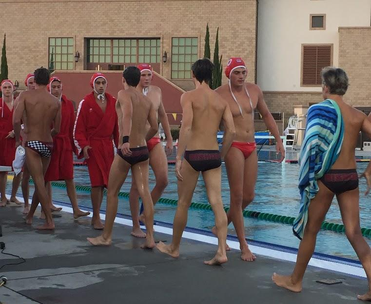 Austin Smit '19 shakes hands with members of The Bishops School water polo team after his team won its game. The look of exhaustion does not prevent good sportsmanship from closing the game.