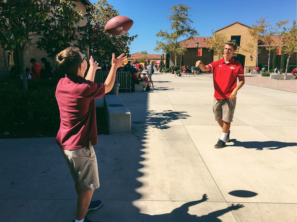 In an effort to make the most of the lunch period, Options mentor, Grant McDonald '17, and his Options student, Thomas Byrne '20, both football fans, engage in a friendly toss-and-catch game in the quad.