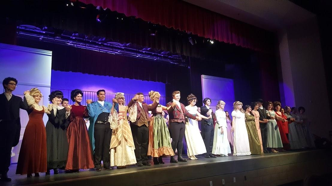 The cast and crew of the Cathedral Catholic High School fall play, Pride and Prejudice, bow at the end of their first performance last Friday.
