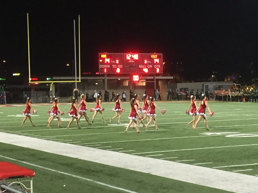 The CCHS Dance Team struts into the Southwestern College stadium field for their halftime performance during the CIF Open Division Championship game between Cathedral Catholic High School and Helix High School.