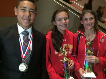 CCHS students competed in a local speech competition, with Elijah Summerlin finishing in seventh place and Isabelle Bursulaya placing in first in their respective events. Kate Fernandez accepts the award for the best Speech and Debate team.