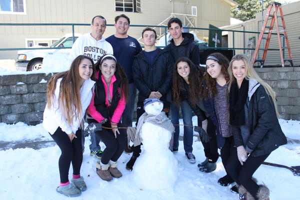 CCHS Principal Mr. Kevin Calkins and Graham Valentine's '17 participate in a small group activity during the inaugural Kairos snowman-making-contest at Palomar Christian Conference Center.