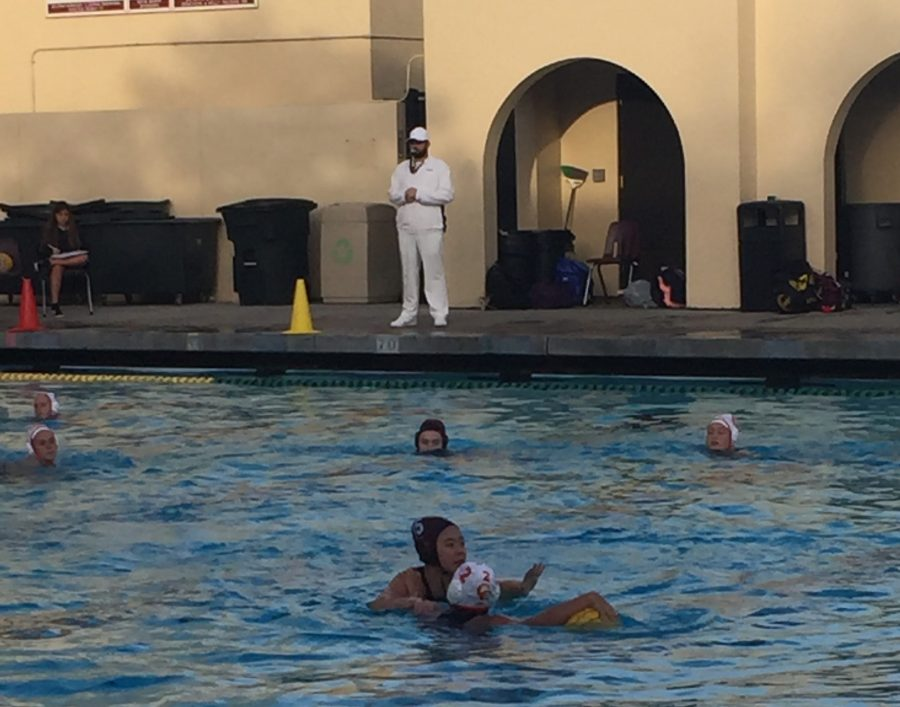 CCHS Varsity Water Polo player fights the Bishop Knight's to keep possession of the ball and score one for the Dons.