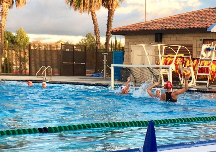 Hoisting herself up from the water, CCHS student-athlete Laura Larkin '18 swivels her arm into position to score on Tuesday against Rancho Bernardo High School.