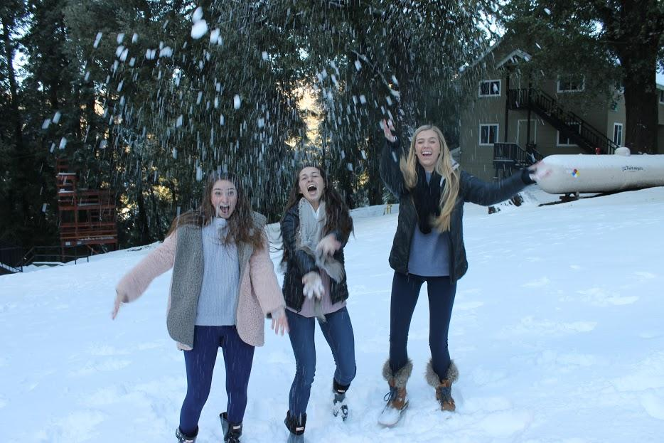 After reflecting on the importance of community and love at the recent Kairos 2 retreat in the Palomar Mountains, Cathedral Catholic High School students Sophia Battiata '17, Lauren Mammini '17, and Aerin Keeney '17 take a break by playing in the snow. Pope Francis issued an exhortation titled Amoris Laetitia that delivers an inclusive message of love.