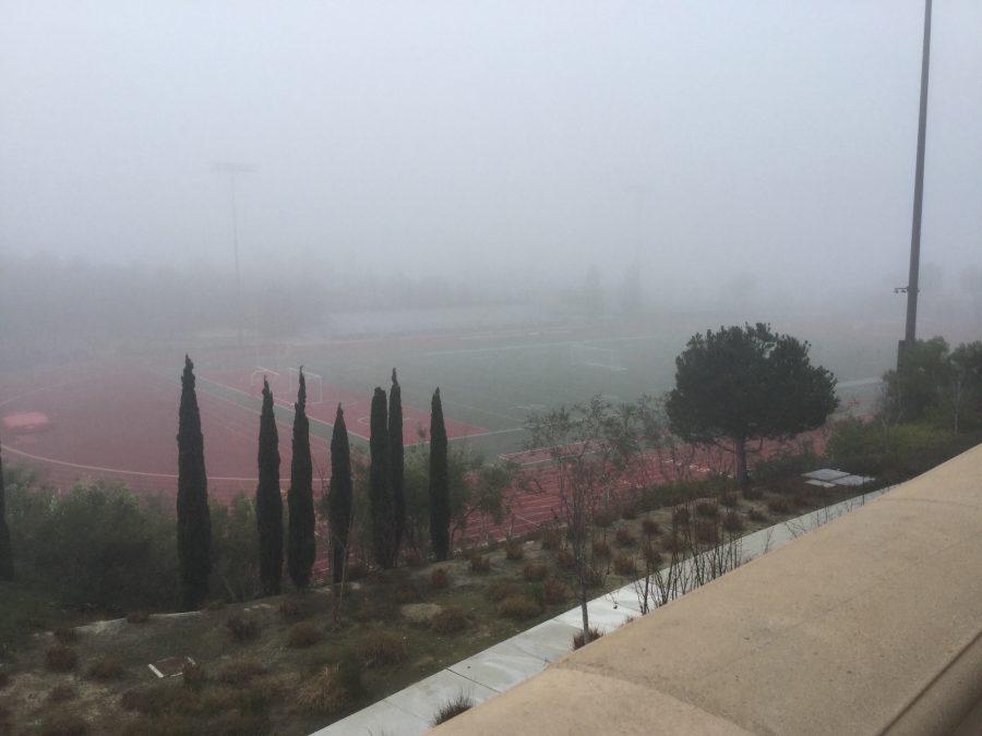 Fog rolls over Manchester Stadium, preparing athletes for spring weather.