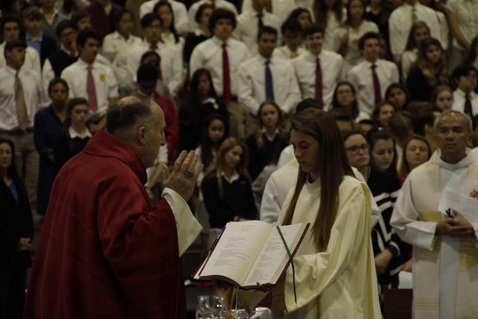 Bishop Robert McElroy celebrates the liturgy of St. Polycarp with the help of CCHS altar server Anna Bourke '18, immersing himself into the community as one of school's own members.