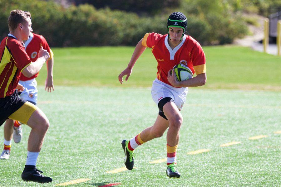 CCHS varsity rugby player Ben Smith '18, who injured his leg during Saturday's match, helped the rugby team win its final match of the season against Poway High School.