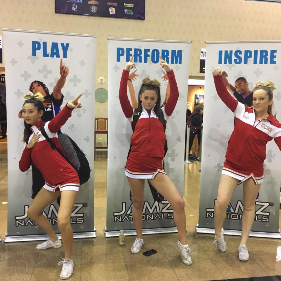 Vanessa Lee '18, Shelby Thompson '17, and Katie Vandeventer '17 strike a pose at the 2017 JAMZ National Cheer Competition in Las Vegas, Nevada.