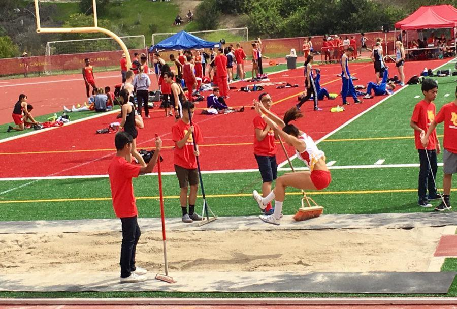 At the Mount Carmel High School Track and Field Meet Saturday, Lady Don Cambria Galloway '17 soars 17 feet over the sand in the long jump event.
