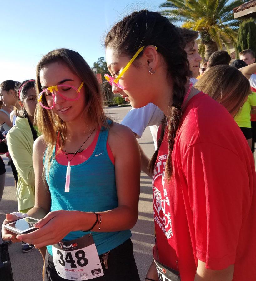 CCHS students Madisen Miller and Vanessa Lee await the start of Saturday's neon-themed Dons Dash, an annual event put on by the CCHS Hispanic Awareness Club and Dons Alumni.