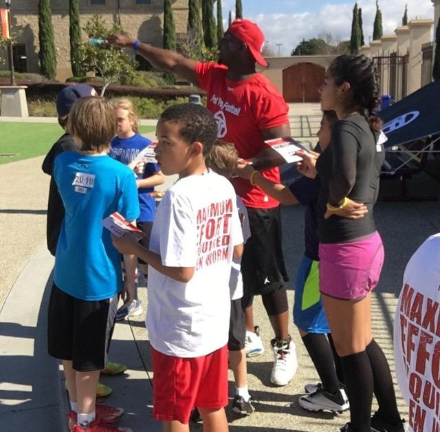 Youngsters gather for a pep talk Saturday in preparation for their flag football game.