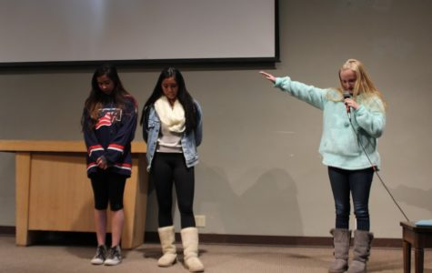 Senior retreat leader Sarah Lackey '17 prays over Hailey Nagma '17 and Danielle Rizzo '17 as they prepare to deliver testimonials in front of the junior girls attending the March Junior Retreat in Julian.