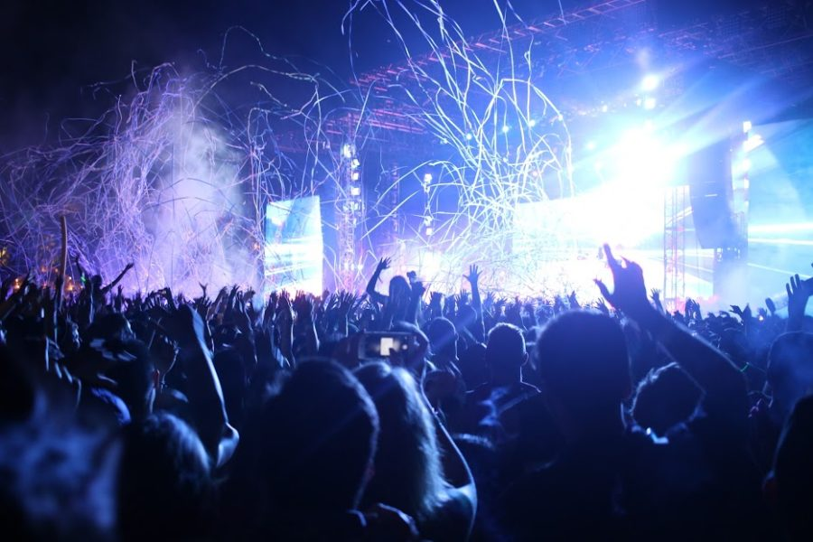 Concertgoers at last year's Coachella Valley Music and Arts Festival revel in the pulsating music and light show. This year's event is expected to attract nearly 100,000 people per day to the festival, which spans two weekends in April.